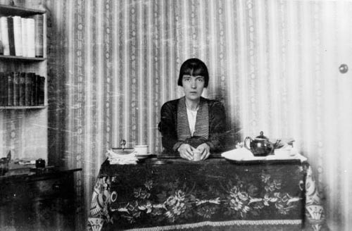 Katherine Mansfield at her work table, tea tray bes…rary 1-2-011985-F  .jpg